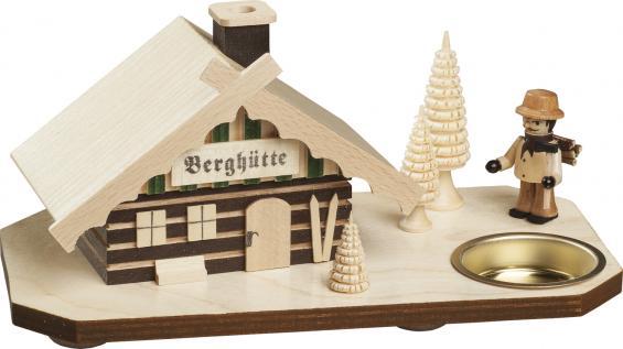 Berghütte mit Holzfäller